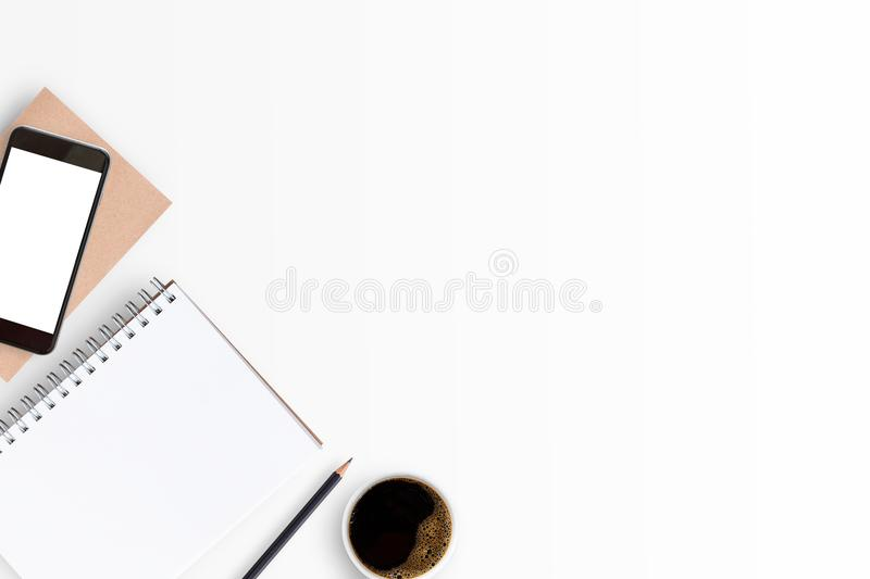Top view of white office table or office desk with blank notebook stock image