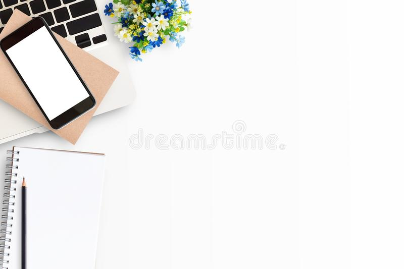 Top view of white office table or office desk with laptop computer stock images