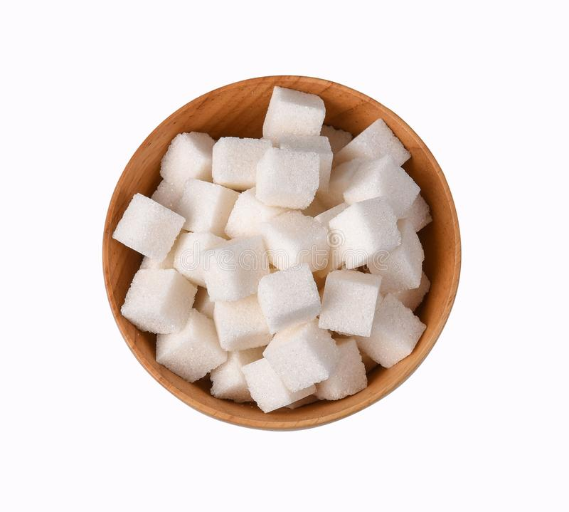 Top view of white pure sugar cubes in wooden bowl isolated on white background. Top view of white pure sugar cubes in wooden bowl sweet isolated on white royalty free stock photos