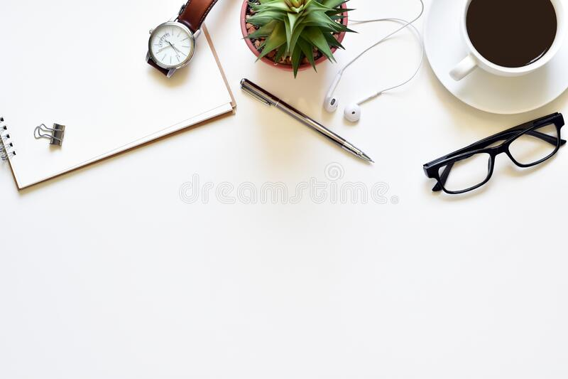 Top view white table, Design your own desk with book, pen, glasses, black coffee and wristwatch is elements. stock photo