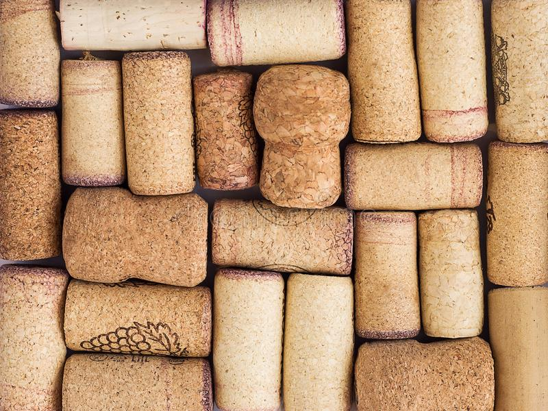 Wine and champagne corks with red stains. Top view of wine and champagne corks with red stains. Vintage background stock image