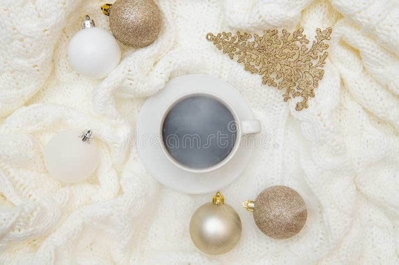 Top view winter christmas warm cozy mock up. Flat lay on white background - cup of coffee, knitted plaid, sweater mockup royalty free stock images