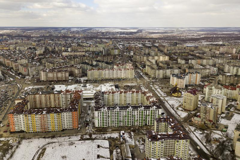 Top view of winter city landscape with tall buildings and parked cars. Drone aerial photography.  stock photos