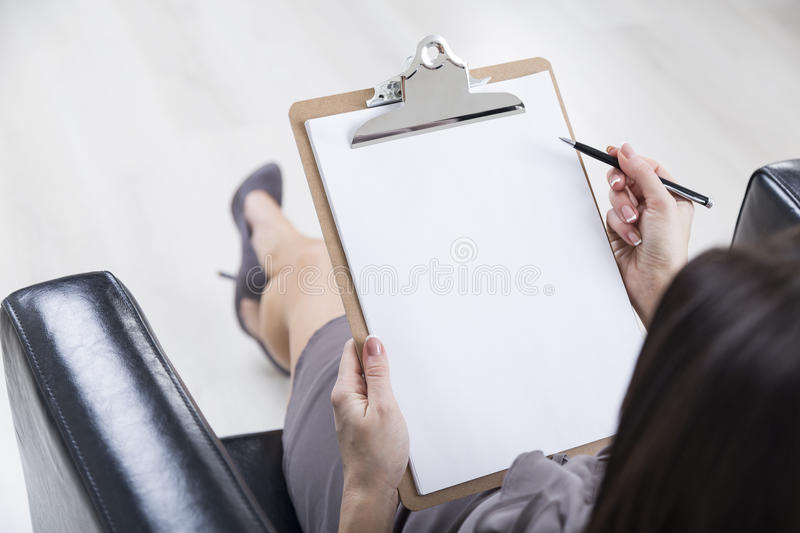 Top view of woman hand with clipboard stock photography