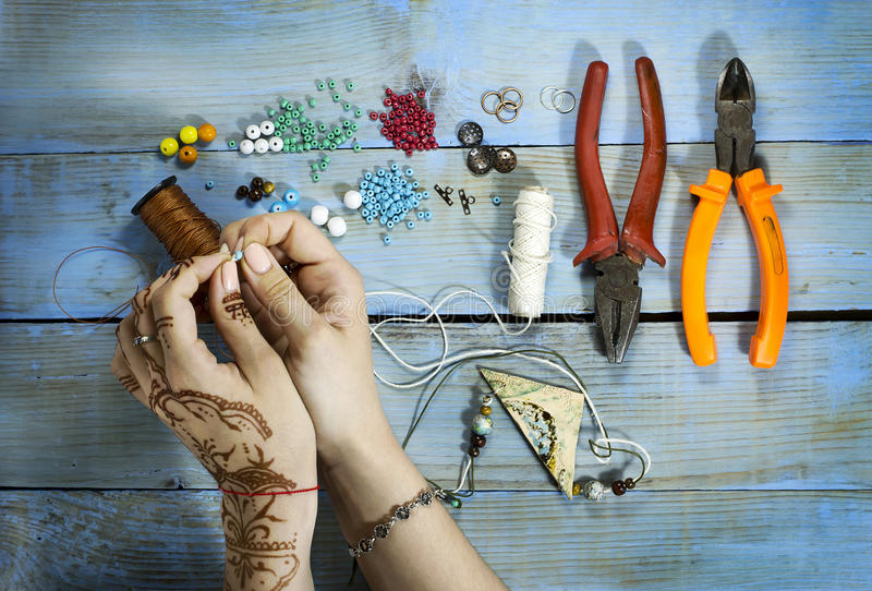 Top view of woman hand making handmade ceramic accessories. On wooden table stock photo