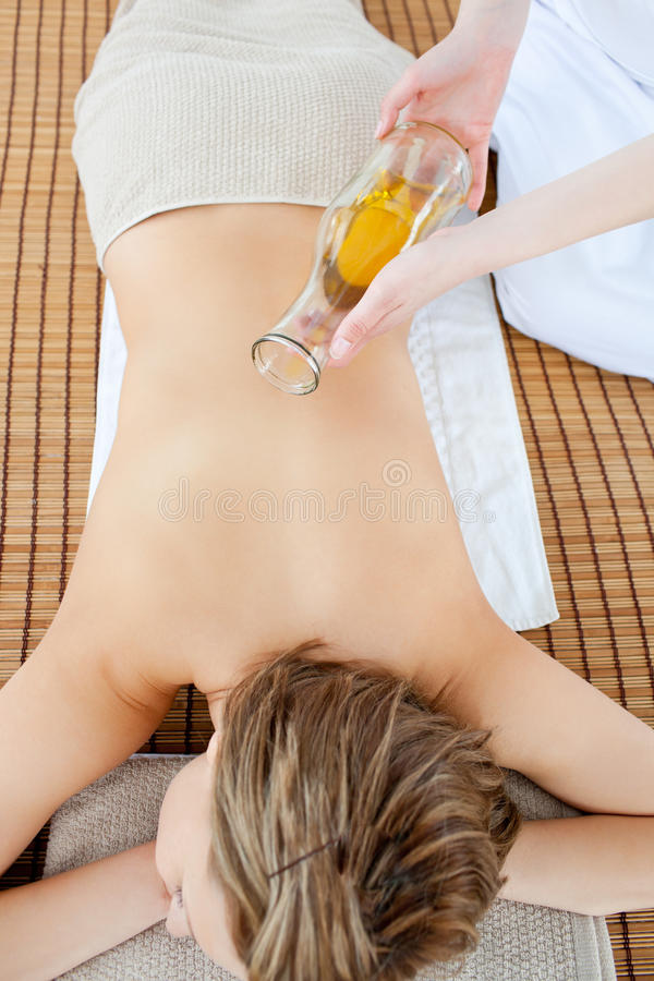Top view of a woman having a oil massage. Lying on a massage table stock image
