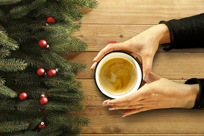 Top view of woman`s hands holding hot drink. Free space for your decoration. Cup of hot chocolate or coffee. royalty free stock image