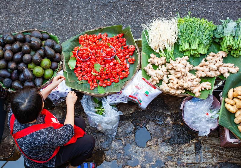 Top view of woman selling fresh fruit and vegatables - Thailan. Business, popular, tradition, canal, asia, floating, tourist, local, travel, vegetable, tourism royalty free stock images