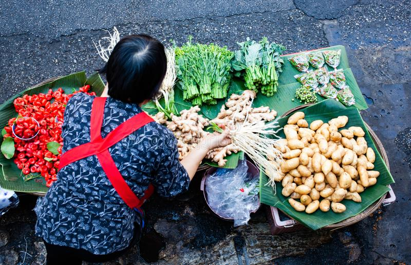 Top view of woman selling fresh fruit and vegatables - Thailan. Business, popular, tradition, canal, asia, floating, tourist, local, travel, vegetable, tourism stock images