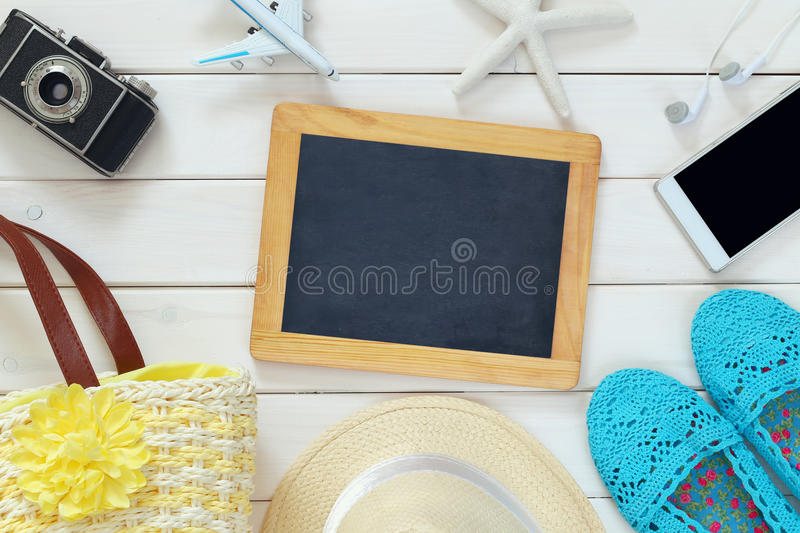 Top view of woman vacation accessories and life style objects. On white wooden background royalty free stock photography