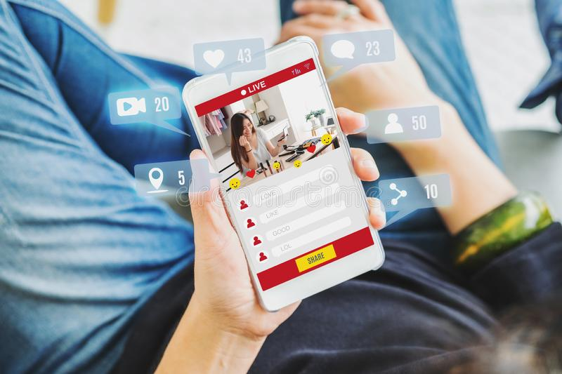 Top view of woman view of beauty blogger review online with mobile apps at home,online influencer technology in daily lifestyle,. Digital age concept stock photo