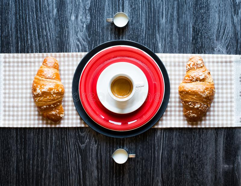 Top view of a wood table full of cakes, fruits, coffee, biscuits stock images