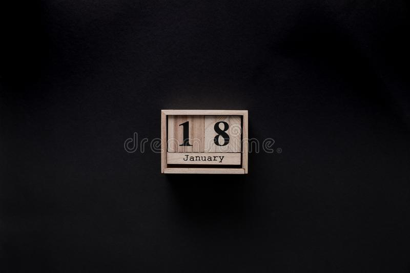 Top view of wooden calendar. Isolated on black royalty free stock photo