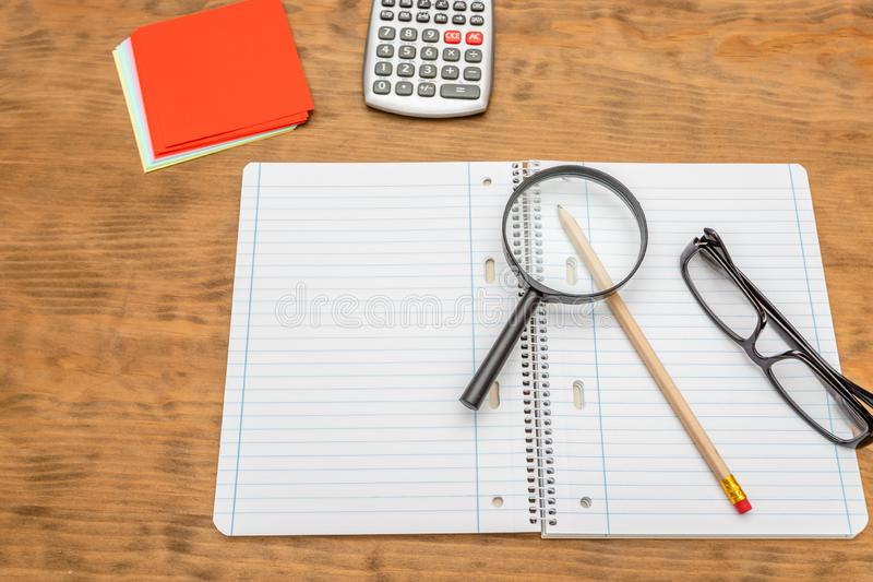 Top view of wooden desktop with office tools. Mock up, soft focus stock photos
