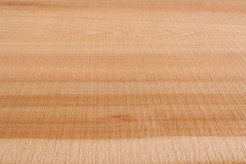 Top view on wooden longitudinal texture larch slab. Selective f. Top view on wooden longitudinal texture larch slab. Perspective view. Selective focus stock photos