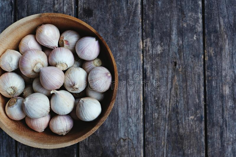 Top view of wooden table full of herbal vegetable ingredients, garlic, red onion, finger root, ginger, copy space. Food concept royalty free stock images