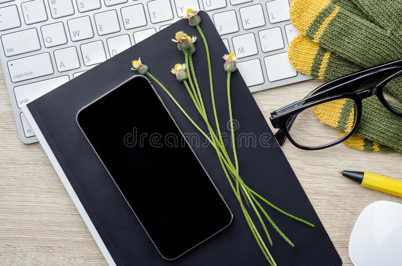 Download Top View Of Wooden Working Table With Blank Smart Phone, Notepad Stock Photo - Image: 83703168