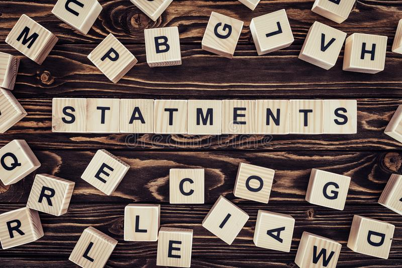 top view of of word statements made of wooden blocks royalty free stock images
