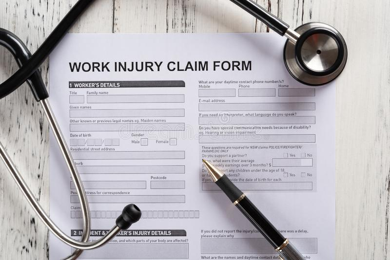 Top view work injury claim form with stethoscope medical and insurance concept stock photo