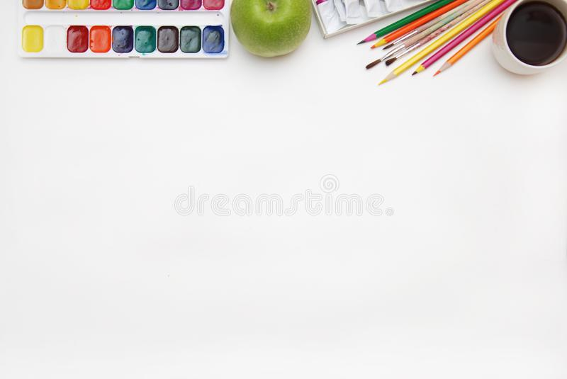 Top view of Work Process Blank Watercolor Paper pad, Watercolor Painting Supplies, Brushes and Colorful Pencil. Creation process o royalty free stock photos