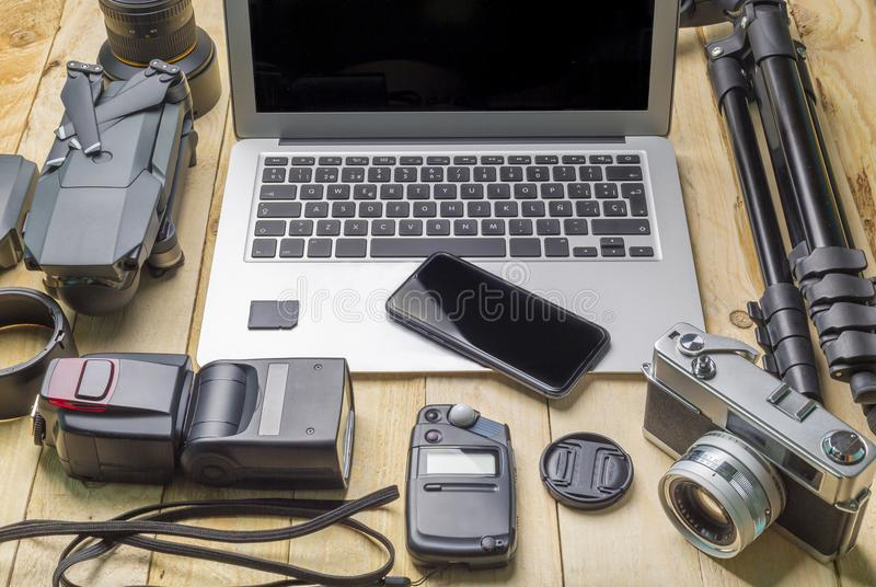 Top view of work space photographer and travel concept with camera, drone,flash, royalty free stock photography