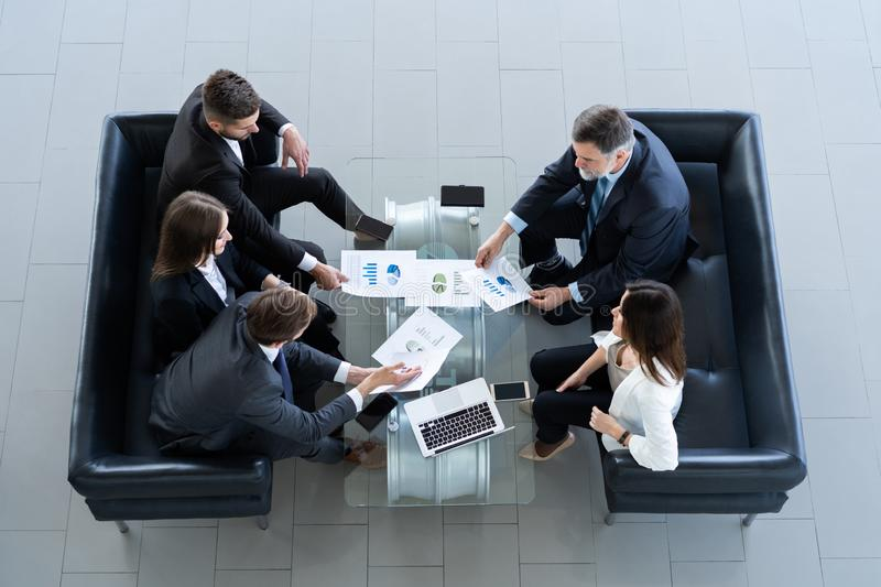 Top view of working business group sitting at table during corporate meeting. royalty free stock images