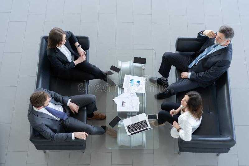 Top view of working business group sitting at table during corporate meeting. stock photo