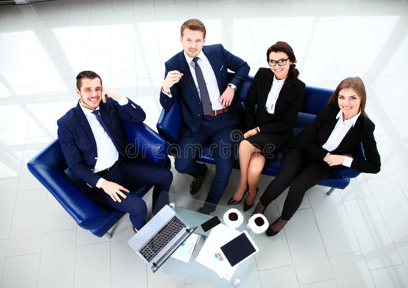 Top view of working business group sitting at table stock photo