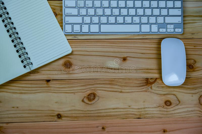 top view of working desk table with keyboard, mouse, notebook stock photo