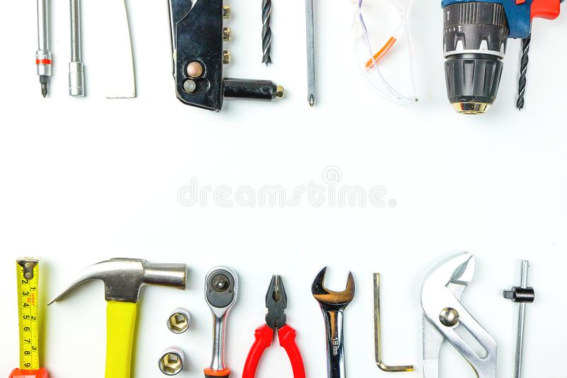 Top view of Working tools,wrench,socket wrench,hammer,screwdriver,plier,electric drill,tape measure,machinist square and safety g royalty free stock photos