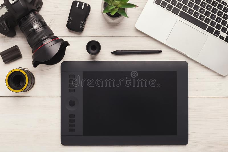 Designer workplace with graphic tablet and laptop royalty free stock image