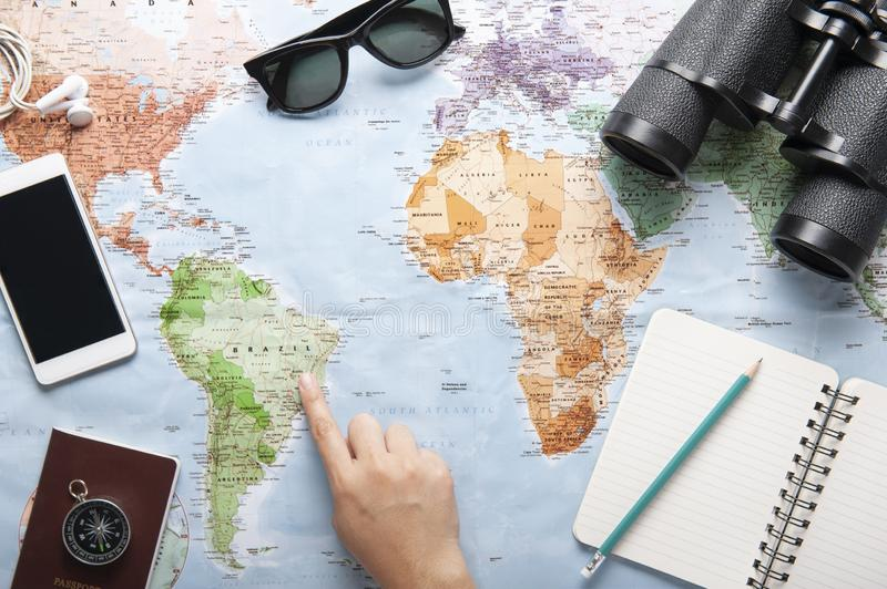 Top view of world map, sunglasses, binocular and passport with texting space stock images