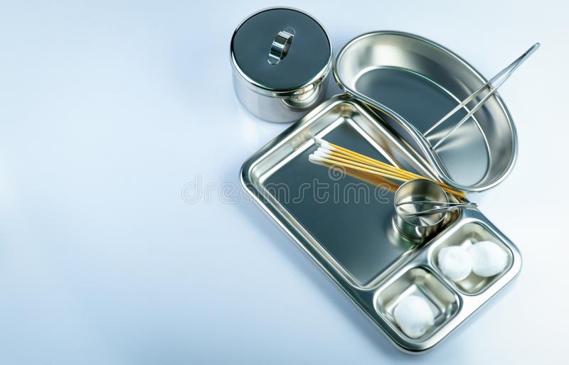 Top view of wound care dressing set and stainless steel plate, forceps, cotton balls, cotton sticks, iodine cup, instruments. Container. Medical supply royalty free stock photography