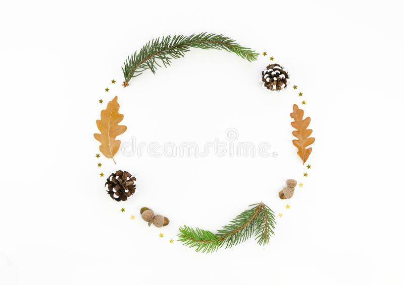 Top view 2020 Xmas and New Year wreath mockup made of branches, pine cones and leaves. Minimal holiday concept stock photo