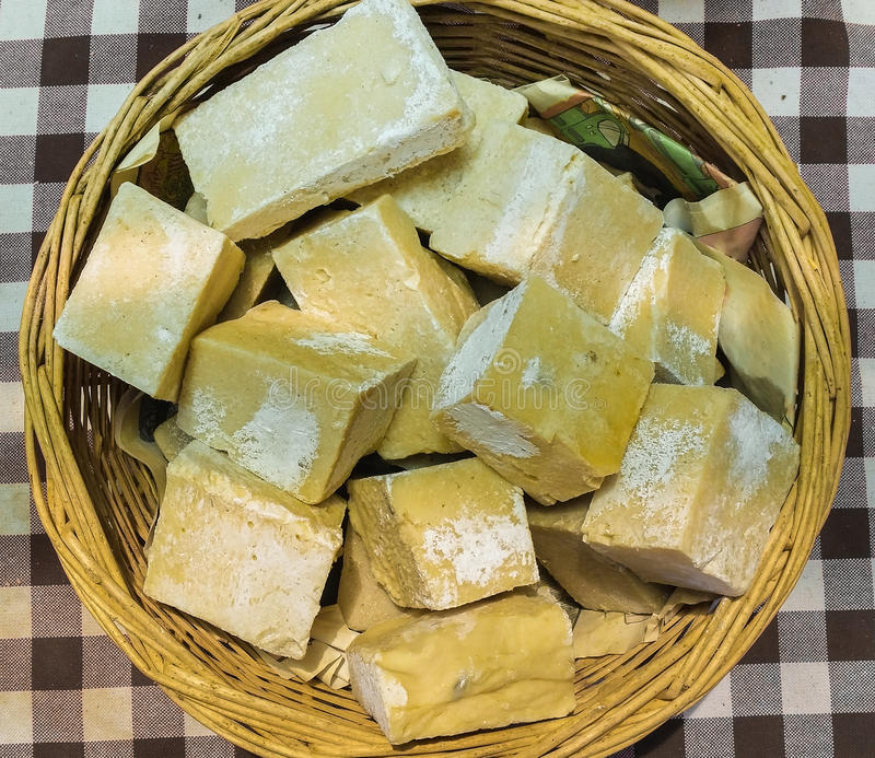 Top view of yellow organic handmade soaps in a basket royalty free stock images