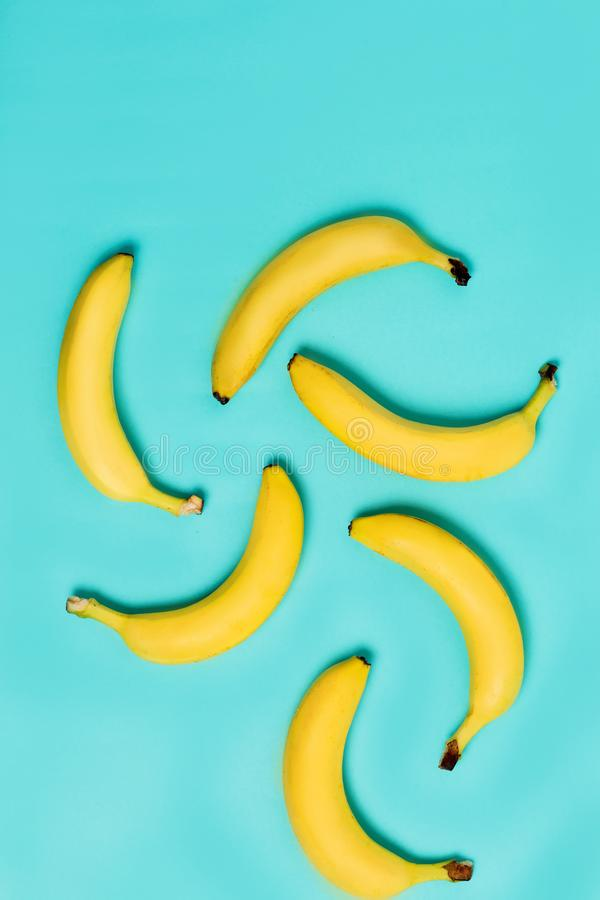 Top view of yellow, ripe bananas on a pastel blue royalty free stock images