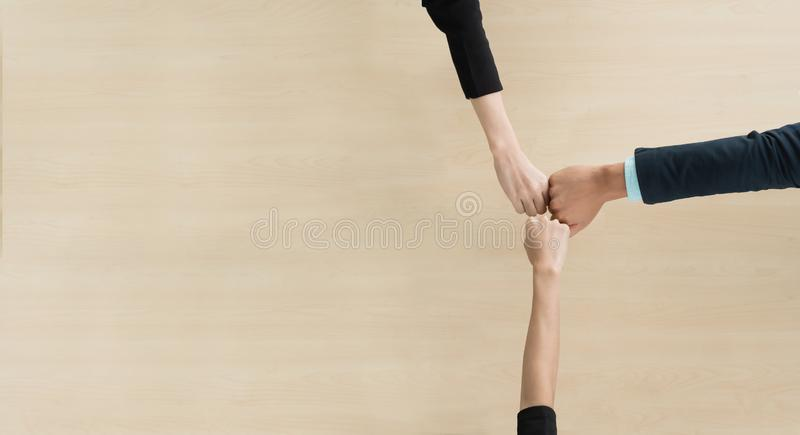 Top view of Young business people partners doing fist bump royalty free stock image