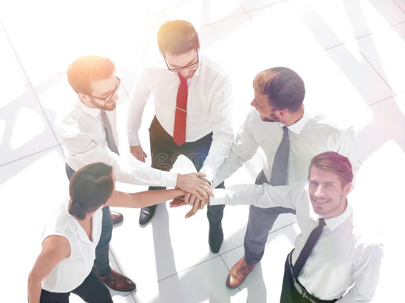 Top view. young business team showing their unity. royalty free stock image