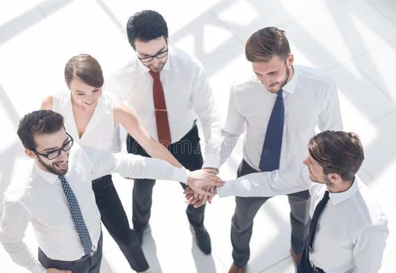 Top view. young employees showing their unity stock images