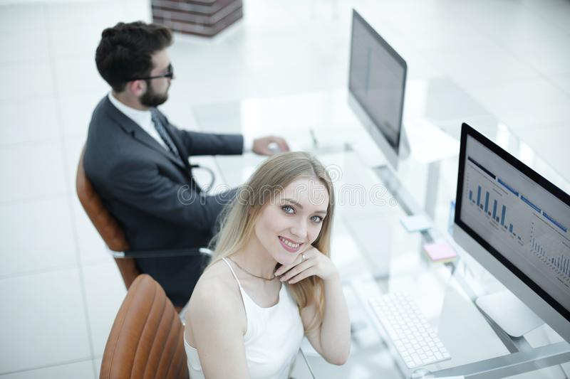 Top view young financial department employee in the office. Top view young financial department employee sitting in the workplace and looking at the camera royalty free stock photo