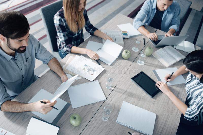 Top view of young group of people working in the office royalty free stock photo