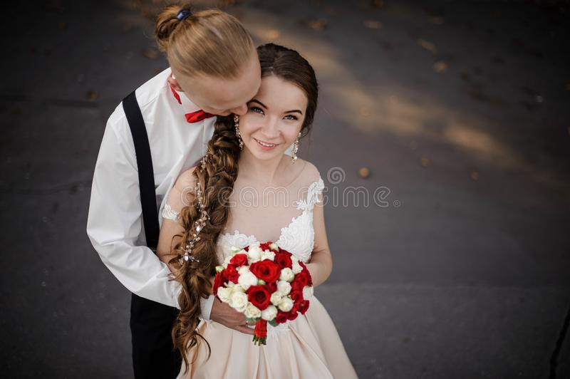 Top view of a young happy married couple with a wedding bouquet royalty free stock image