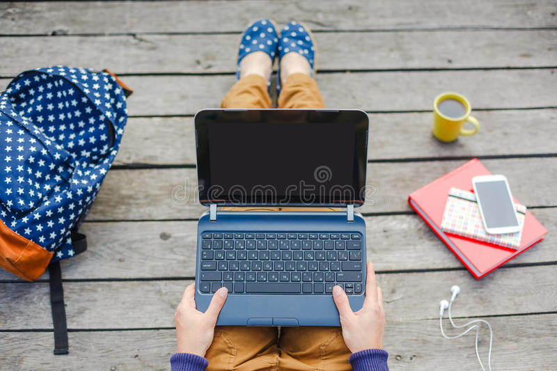 Top view of young hipster girl using laptop royalty free stock images