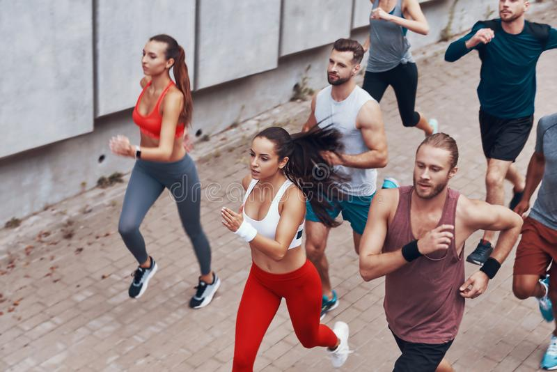 Top view of young people in sports clothing royalty free stock image