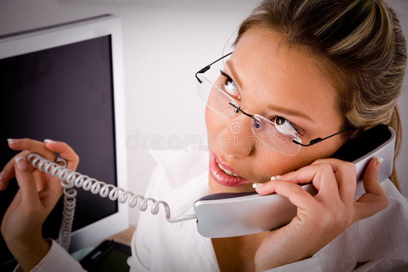 Top view of young professional talking on phone royalty free stock image
