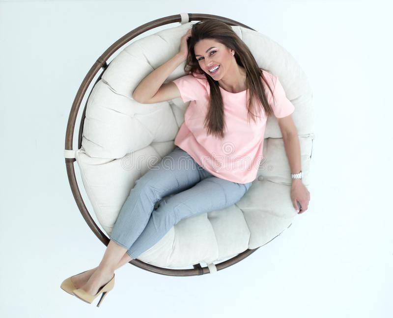 Top view.young woman relaxing in a comfortable chair stock photos