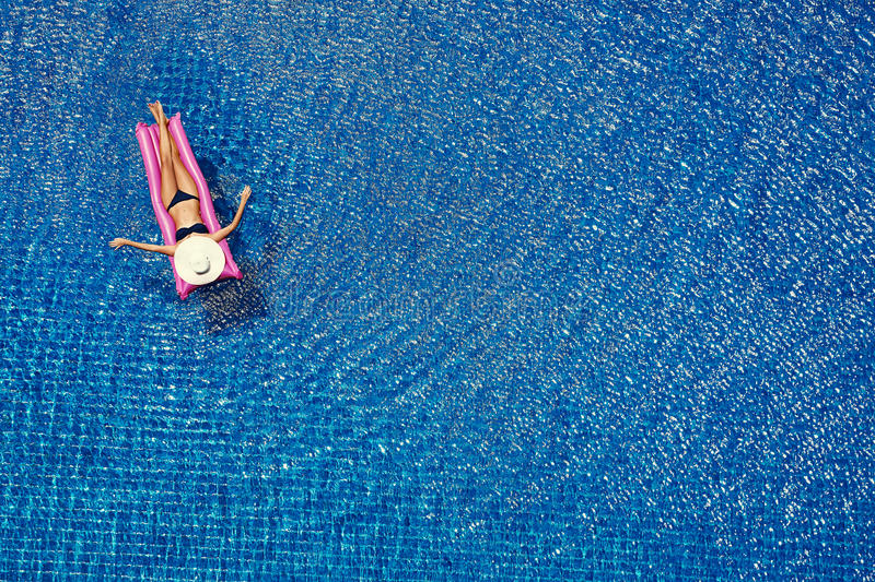 Top view of young woman in the swimming pool stock photos