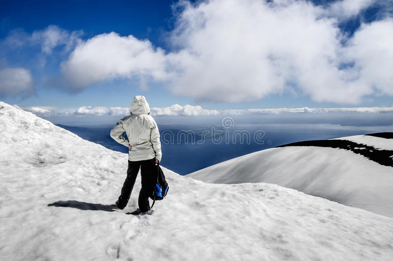 At the top of the volcano Osorno. Osorno Volcano is a 2,652-metre (8,701 ft) tall conical stratovolcano lying between Osorno Province and Llanquihue Province, in royalty free stock photos