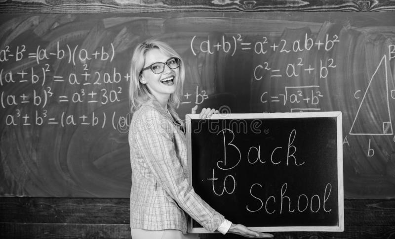 Top ways to welcome students back to school. Teacher woman hold blackboard inscription back to school. It is school time. Again royalty free stock photo