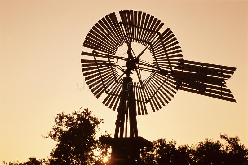 Top of windmill. Against pale orange sky stock photography